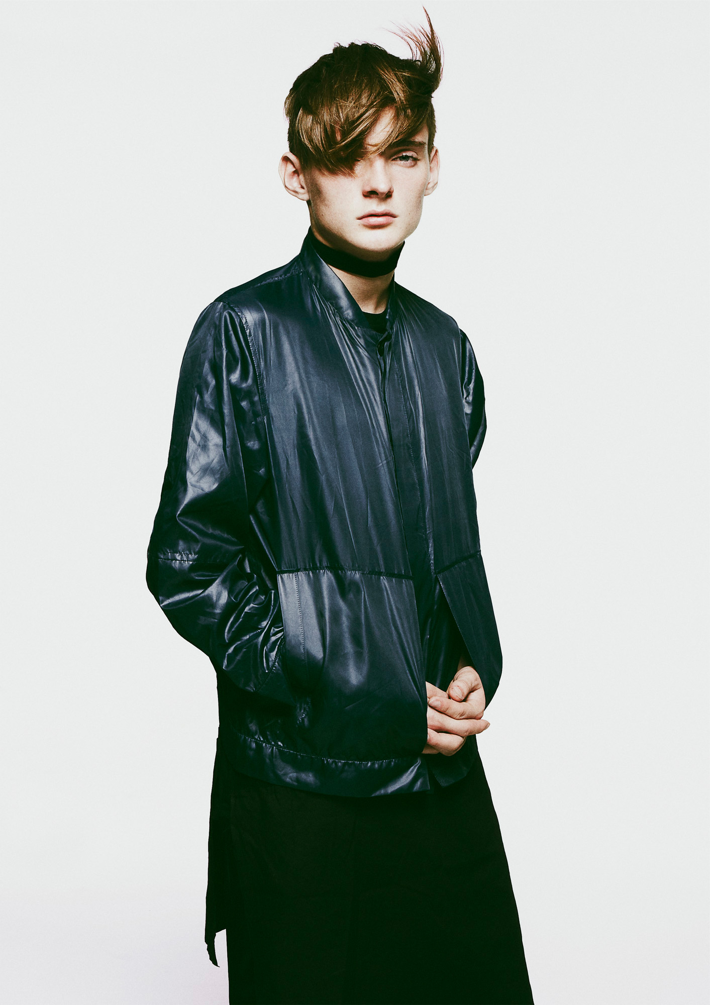 Wool choker, wet look nylon bomber jacket, cotton t-shirt undergarment and cotton trousers by Craig Green