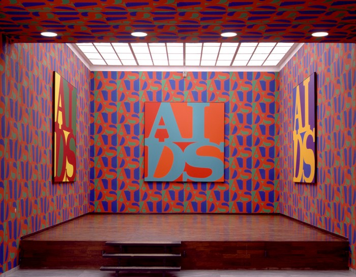 General Idea, 'AIDS', 1988. Acrylic on canvas, serigraph wallpaper. Installation view, Württemburgischer Kunstverein, Stuttgart, Germany. Image courtesy the Württemburgischer Kunstverein