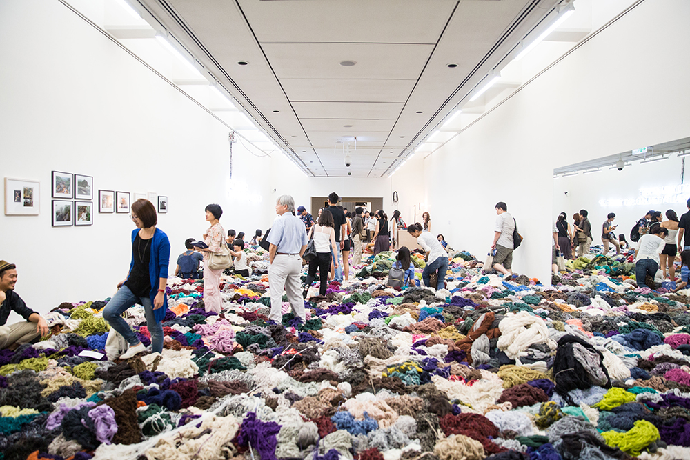Surasi Kusolwong 'Golden Ghost (Reality Called, So I Woke Up)' – 12 gold necklaces with symbol made and designed by the artist are hidden in industrial thread waste of 5 tons in the exhibition space. 2014. Courtesy Taipei Fine Arts Museum