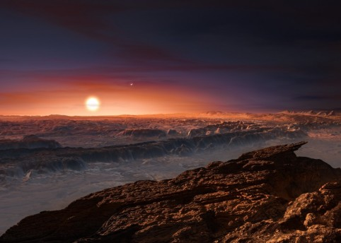 This artist's impression shows a view of the surface of the planet Proxima b orbiting the red dwarf star Proxima Centauri, the closest star to the solar system. (Credit- ESO:M. Kornmesser)