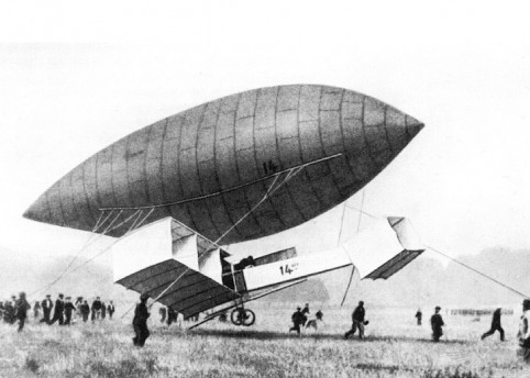 Alberto Santos-Dumont tests the controls of his first aircraft with it suspended from his number 14 airship