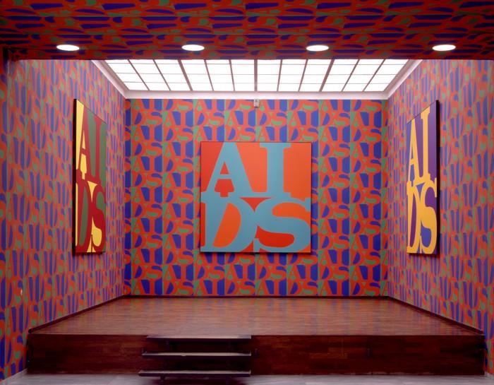 General Idea, 'AIDS', 1988. Acrylic on canvas, serigraph wallpaper. Installation view, Württemburgischer Kunstverein, Stuttgart, Germany. Image courtesy the Württemburgischer Kunstverein