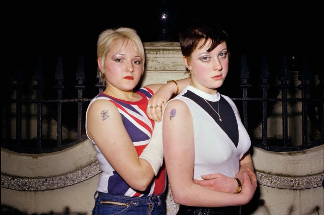 Carrie Kirkpatrick (left) and Gill Soper outside the toilets in Crystal Palace London in November 1980. Photo by Anita Corbin