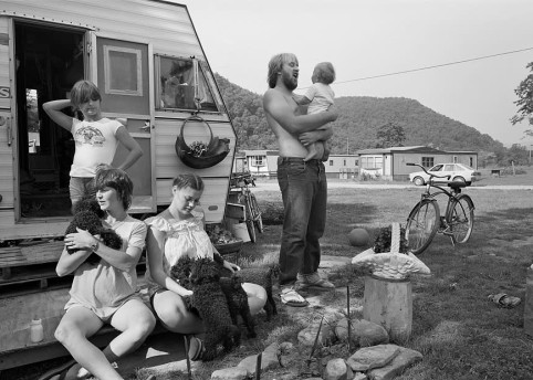 Family with Poodle puppies, Mill Creek, West Virginia, 1982