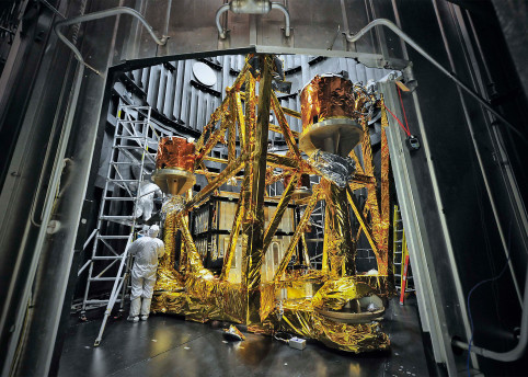 Above: Support structures wrapped in gold thermal blankets that resemble a golden cage. The structure is housed within the vacuum chamber called the Space Environment Simulator, or SES. The SES is located at NASA's Goddard Space Flight Center in Greenbelt, Md., where components of the James Webb  Space Telescope are tested to withstand the extreme temperatures of space. Image courtesy of NASA.
